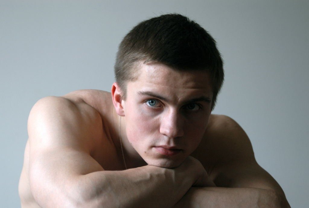 Young Sexy Man Leaning on His Arms